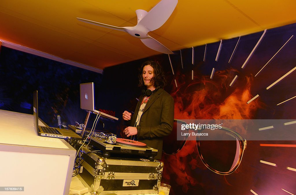 Musician <a gi-track='captionPersonalityLinkClicked' href=/galleries/search?phrase=Nick+Valensi&family=editorial&specificpeople=651473 ng-click='$event.stopPropagation()'>Nick Valensi</a> of The Strokes DJs the Carrera Cocktail Party hosted by AD Oasis at The Raleigh on December 6, 2012 in Miami, Florida.