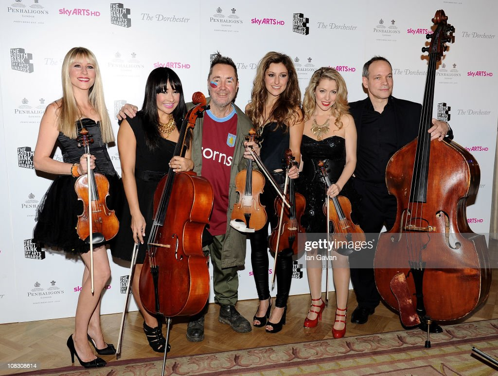 Musician <a gi-track='captionPersonalityLinkClicked' href=/galleries/search?phrase=Nigel+Kennedy&family=editorial&specificpeople=991974 ng-click='$event.stopPropagation()'>Nigel Kennedy</a> (C) poses in the press room with the band Bond at the South Bank Sky Arts Awards at The Dorchester on January 25, 2011 in London, England.