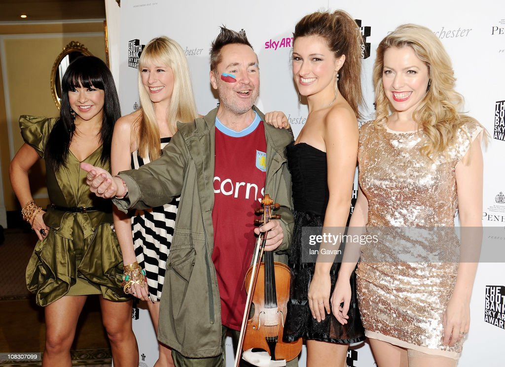 Musician Nigel Kennedy (C) poses with (L-R) Gay Yee Westerhoff, Tania Davis, Elspeth Hanson and Eos Chater of Bond during the South Bank Sky Arts Awards at The Dorchester on January 25, 2011 in London, England.
