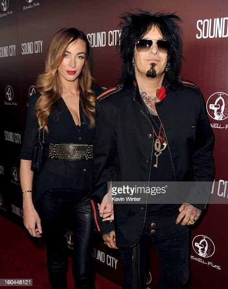 Musician Nikki Sixx and Courtney Bingham arrive at the premiere of 'Sound City' at ArcLight Cinemas Cinerama Dome on January 31 2013 in Hollywood...