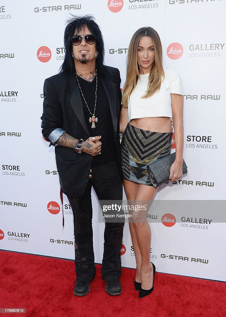 Musician <a gi-track='captionPersonalityLinkClicked' href=/galleries/search?phrase=Nikki+Sixx&family=editorial&specificpeople=213311 ng-click='$event.stopPropagation()'>Nikki Sixx</a> and Courtney Bingham attend the Leica Store Los Angeles grand opening on June 20, 2013 in Los Angeles, California.