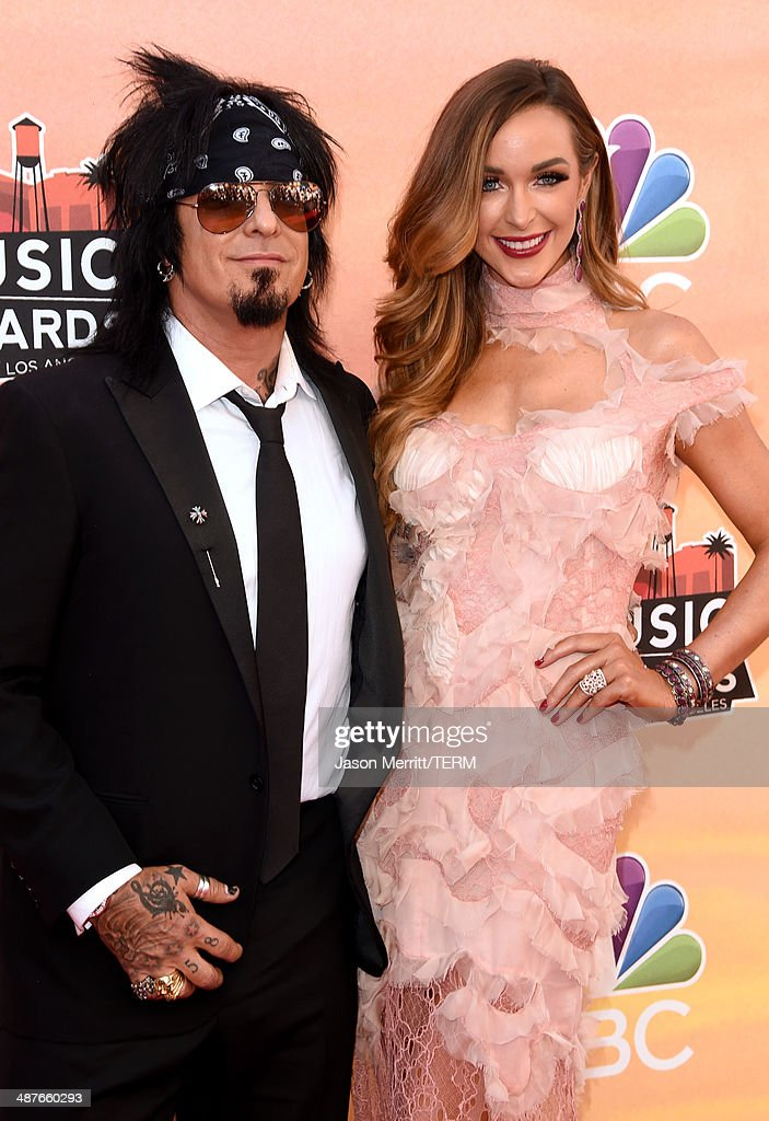 Musician Nikki Sixx (L) and Courtney Sixx attend the 2014 iHeartRadio Music Awards held at The Shrine Auditorium on May 1, 2014 in Los Angeles, California. iHeartRadio Music Awards are being broadcast live on NBC.