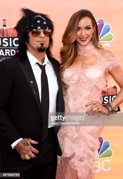 Musician Nikki Sixx and Courtney Sixx attend the 2014 iHeartRadio Music Awards held at The Shrine Auditorium on May 1 2014 in Los Angeles California...