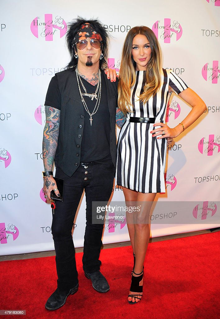 Musician Nikki Sixx and wife Courtney Bingham attend Courtney Sixx hosts a Charity Shopping event at Topshop on July 1 2015 in Los Angeles California