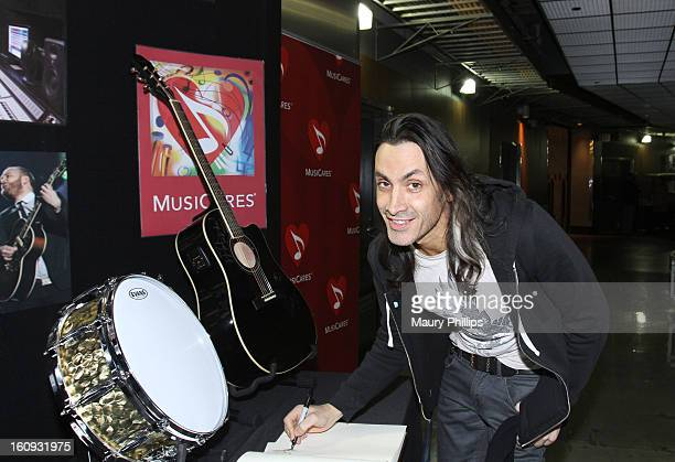 Musician Nuno Bettencourt poses at the MusiCares charity signing booth during The 55th Annual GRAMMY Awards held at STAPLES Center on February 7 2013...
