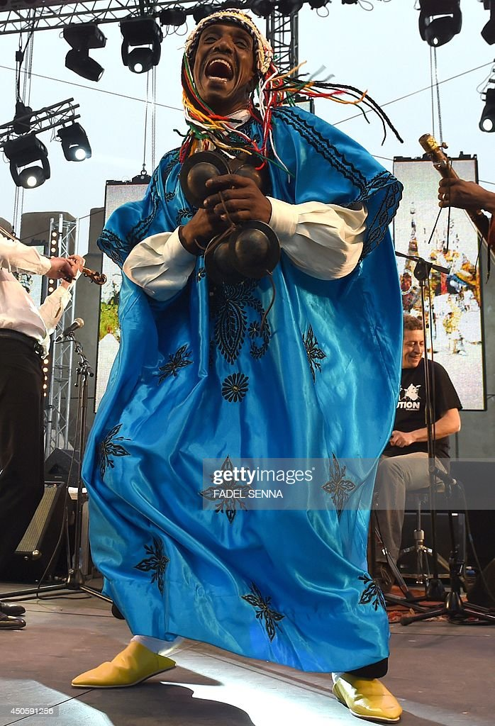 A musician of Moroccan Gnaoua group Maalem Hassan Boussou performs in Essaouira at the Gnaoua World Music Festival on June 13 2014 The annual...