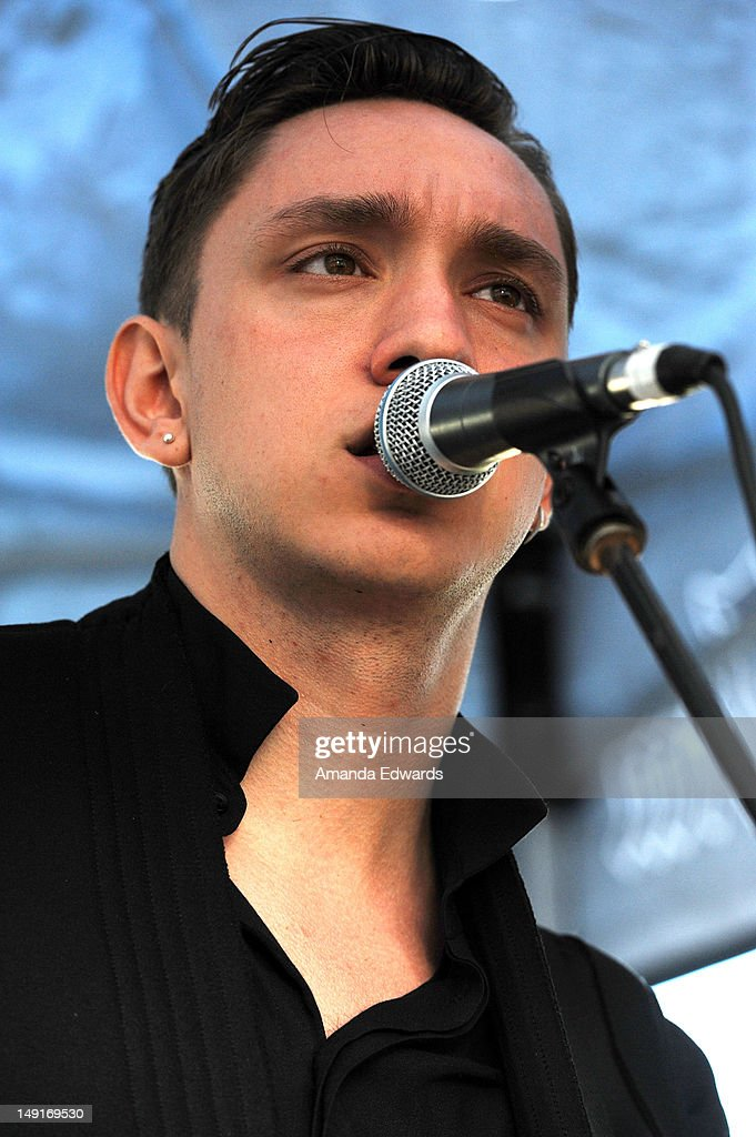 Musician <a gi-track='captionPersonalityLinkClicked' href=/galleries/search?phrase=Oliver+Sim&family=editorial&specificpeople=6078321 ng-click='$event.stopPropagation()'>Oliver Sim</a> of The xx performs onstage at the 98.7 FM Penthouse Party Presents The xx Exclusive Live Performance at The Historic Hollywood Tower on July 23, 2012 in Hollywood, California.