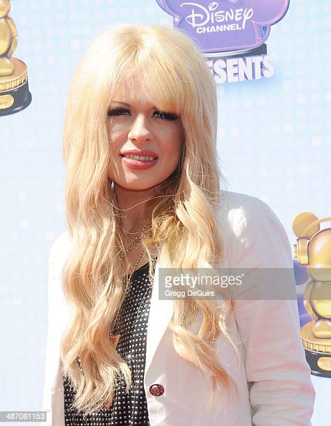 Musician Orianthi arrives at the 2014 Radio Disney Music Awards at Nokia Theatre LA Live on April 26 2014 in Los Angeles California