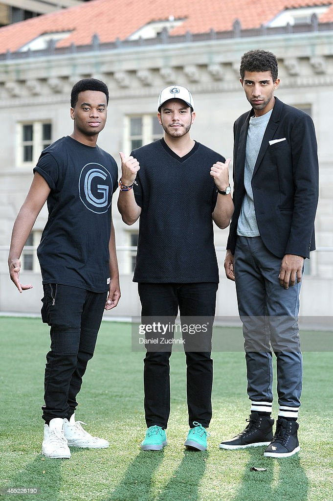 Musician Patrick Toussaint (wearing a Grungy Gentleman x Mitchell & Ness t-shirt), designer Jace Lipstein (wearing a Grungy Gentleman x Mitchell & Ness hat), and actor Rafael Valentino (wearing Grungy Gentleman pants and gray long-sleeve t-shirt) pose for a photo in lower Manhattan on September 10, 2014 in New York City during Mercedes-Benz Fashion Week Spring 2015.