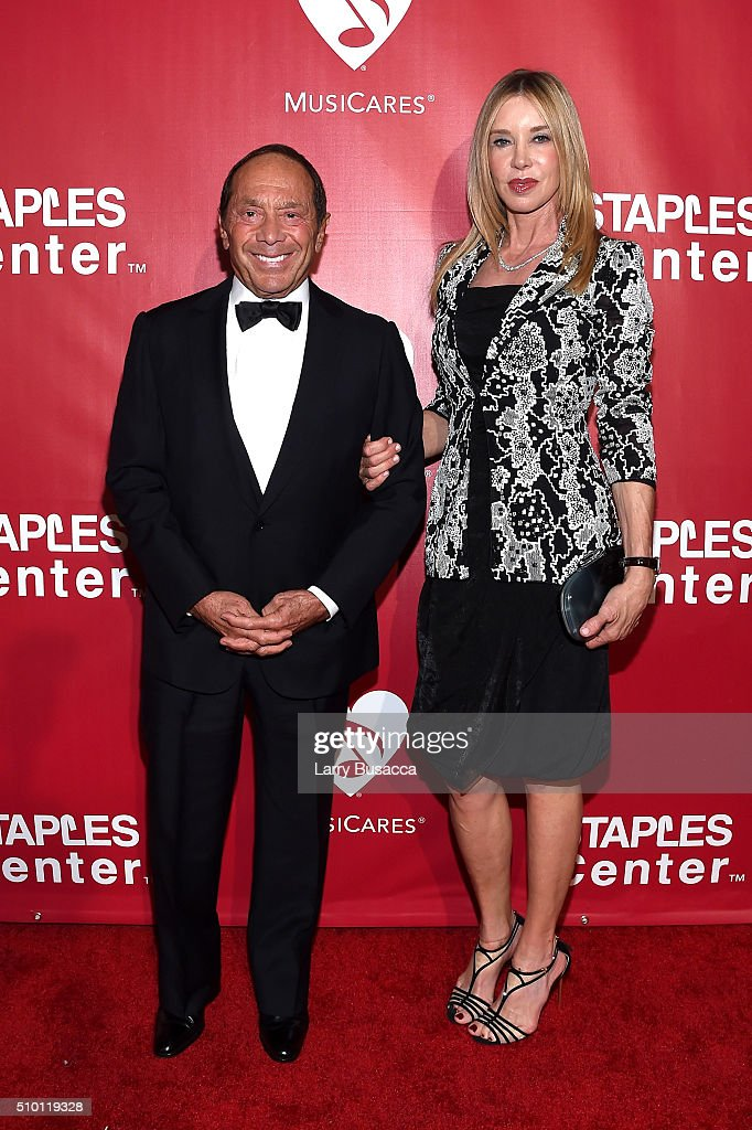 Musician Paul Anka (L) and Lisa Pemberton attend the 2016 MusiCares Person of the Year honoring Lionel Richie at the Los Angeles Convention Center on February 13, 2016 in Los Angeles, California.
