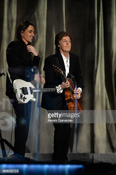 Musician Paul McCartney and guitarist Nuno Bettencourt perform 'FourFiveSeconds' onstage during The 57th Annual GRAMMY Awards at the at the STAPLES...