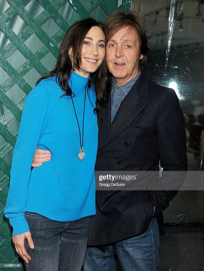 Musician <a gi-track='captionPersonalityLinkClicked' href=/galleries/search?phrase=Paul+McCartney&family=editorial&specificpeople=92298 ng-click='$event.stopPropagation()'>Paul McCartney</a> (R) and wife <a gi-track='captionPersonalityLinkClicked' href=/galleries/search?phrase=Nancy+Shevell&family=editorial&specificpeople=5085391 ng-click='$event.stopPropagation()'>Nancy Shevell</a> arrive at the world premiere of 'My Valentine' video premiere on April 13, 2012 in West Hollywood, California.