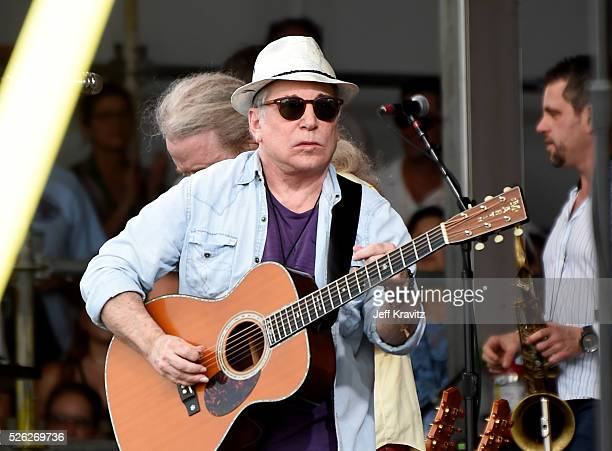 Musician Paul Simon performs onstage during the 2016 New Orleans Jazz Heritage Festival at Fair Grounds Race Course on April 29 2016 in New Orleans...