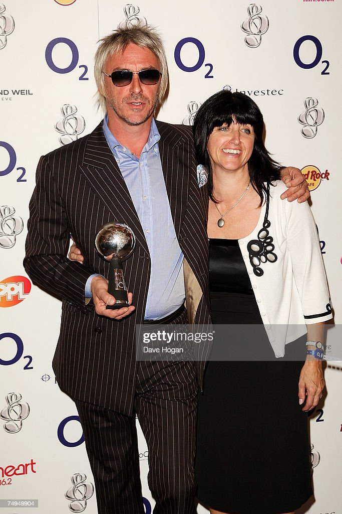 Musician Paul Weller poses with the 'O2 Silver Clef Award' and his sister Nikki in the awards room at the Nordoff-Robbins O2 Silver Clef Luncheon on June 29, 2007 in London, England.