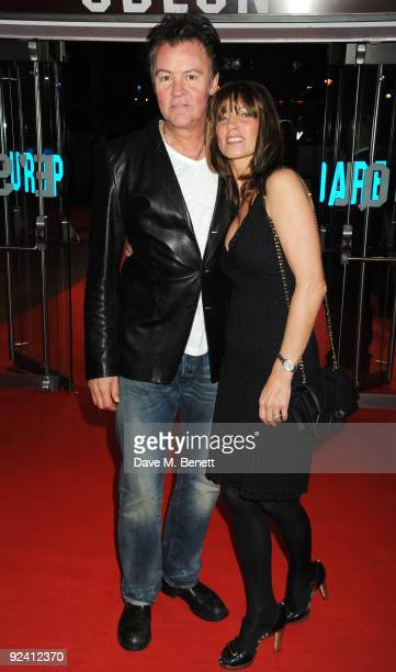 Musician Paul Young and his wife Stacey Young arrive at the UK film premiere of 'This Is It' at the Odeon Leicester Square on October 27 2009 in...