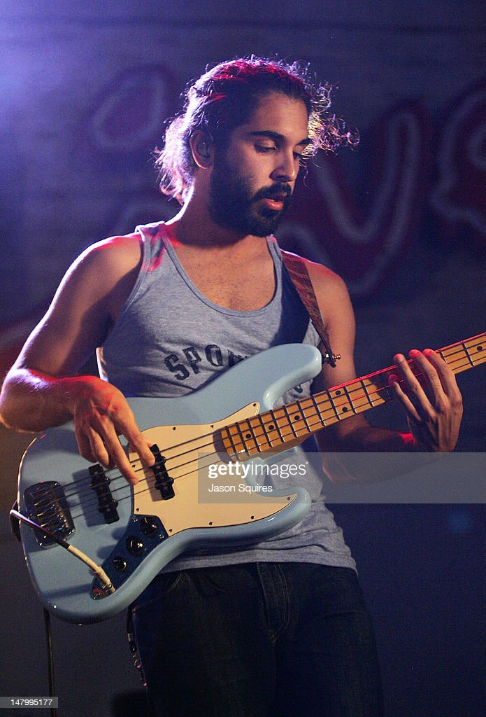 Musician Payam Doostzadeh of Young The Giant performs at the Power & Light District on July 6, 2012 in Kansas City, Missouri.