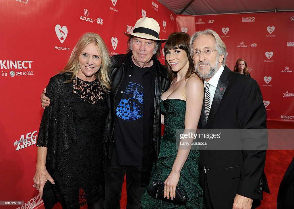Musician Pegi Young, musician Neil Young, Rachel Agosto, and The Recording Academy President and CEO Neil Portnow arrive at the 2012 MusiCares Person of the Year Tribute to Paul McCartney held at the Los Angeles Convention Center on February 10, 2012 in Los Angeles, California.