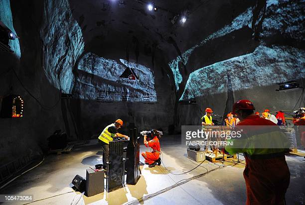 Musician perform before a giant drilling machine completes the world's longest tunnel beneath the Swiss Alps during a ceremony on October 15 30...