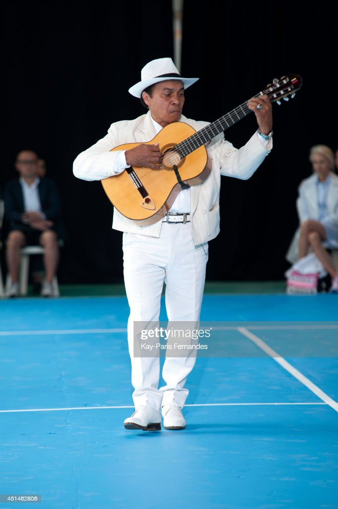 A musician performs during the Umit Benan as part of the Paris Fashion Week Menswear Spring/Summer 2015 on June 29, 2014 in Paris, France.
