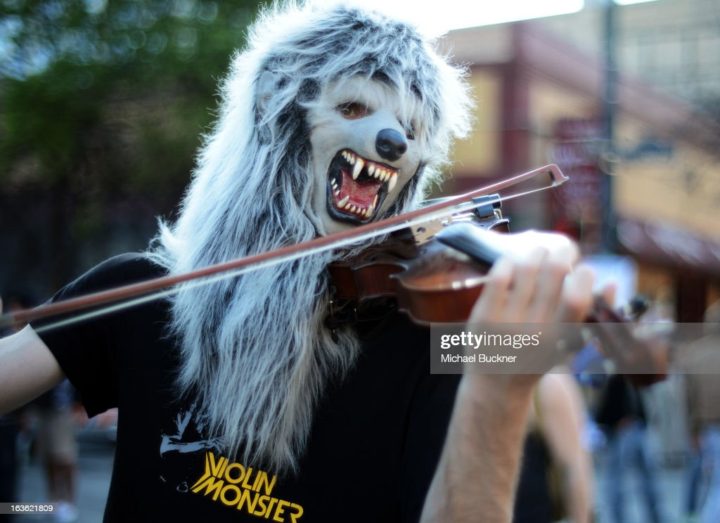 A musician performs on 6th Street during the 013 SXSW Music, Film + Interactive Festival on March 13, 2013 in Austin, Texas.
