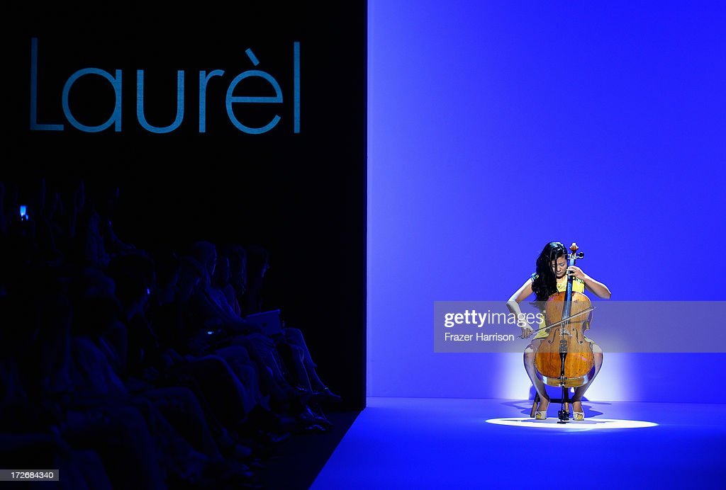 Musician performs on runway at the Laurel Show during the Mercedes-Benz Fashion Week Spring/Summer 2014 at Brandenburg Gate on July 4, 2013 in Berlin, Germany.