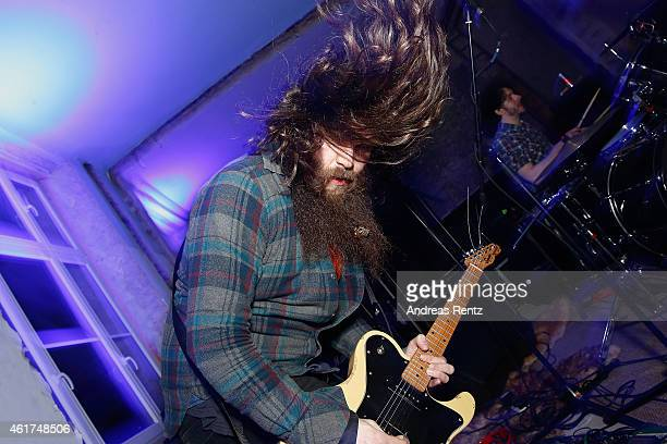 A musician performs on stage at the Dandy Diary and Zalando Fashion Week Party on January 18 2015 in Berlin Germany