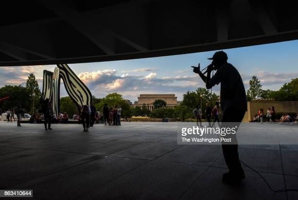 A musician performs on the plaza of the Hirshhorn Museum for their Summer Evenings@Hirshhorn in the Southwest quadrant of town on August 2017 in...
