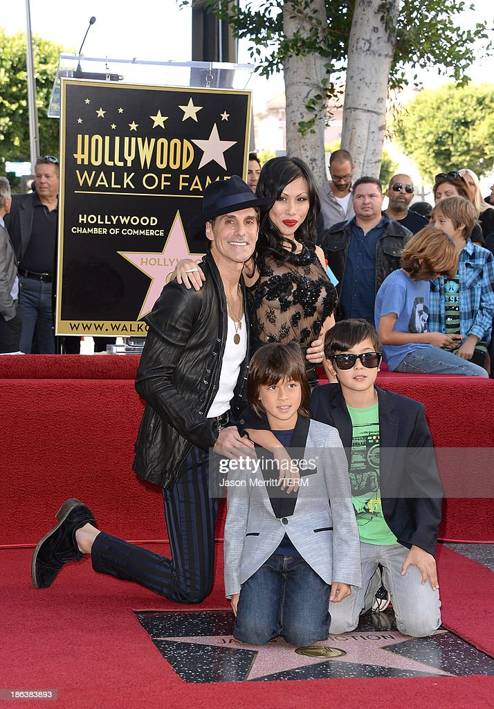 Musician Perry Farrell and his wife Etty Farrell along with children Hezron Wolfgang and Izzadore Bravo attend the ceremony honoring Jane's Addiction with a Star on The Hollywood Walk of Fame on October 30, 2013 in Hollywood, California.