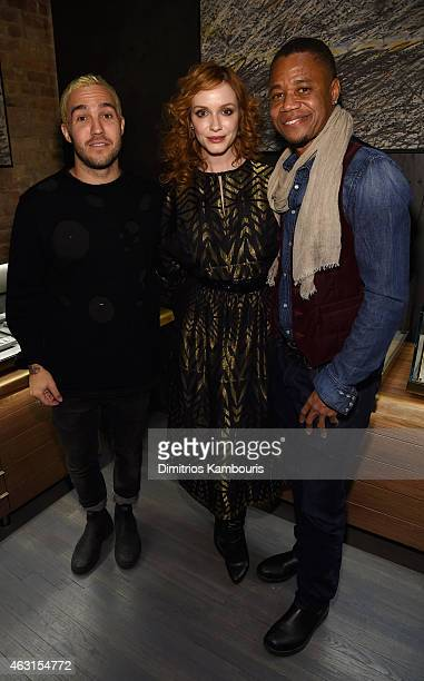 Musician Pete Wentz poses for a photo with actors Christina Hendricks and Cuba Gooding Jr at the David Yurman Soho Boutique Grand Opening event to...