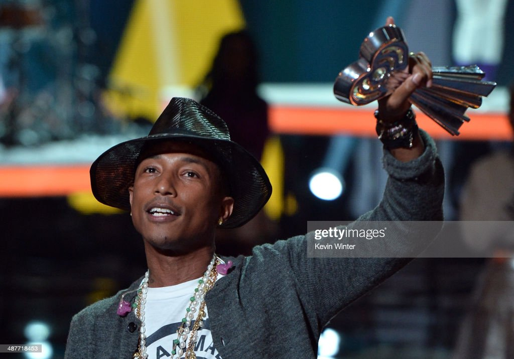 Musician <a gi-track='captionPersonalityLinkClicked' href=/galleries/search?phrase=Pharrell+Williams&family=editorial&specificpeople=161396 ng-click='$event.stopPropagation()'>Pharrell Williams</a> accepts the iHeartRadio Innovator Award onstage during the 2014 iHeartRadio Music Awards held at The Shrine Auditorium on May 1, 2014 in Los Angeles, California. iHeartRadio Music Awards are being broadcast live on NBC.