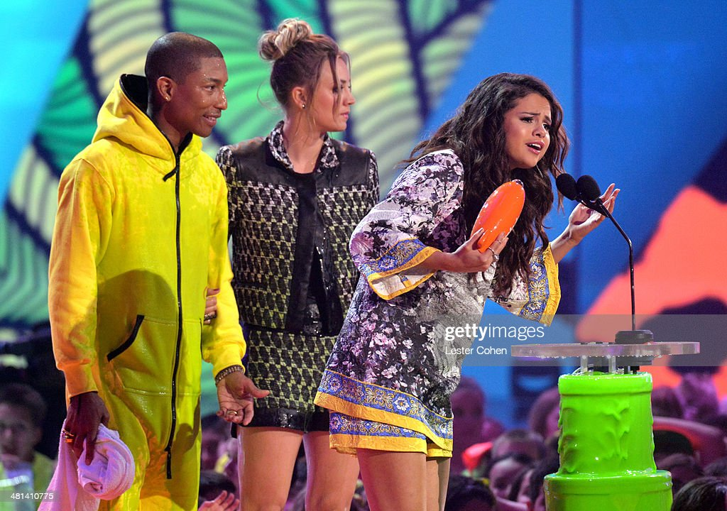 Musician Pharrell Williams, actress Kaley Cuoco, and singer Selena Gomez onstage during Nickelodeon's 27th Annual Kids' Choice Awards held at USC Galen Center on March 29, 2014 in Los Angeles, California.