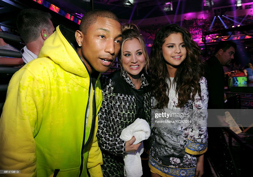 Musician Pharrell Williams, actress Kaley Cuoco, and singer Selena Gomez during Nickelodeon's 27th Annual Kids' Choice Awards held at USC Galen Center on March 29, 2014 in Los Angeles, California.