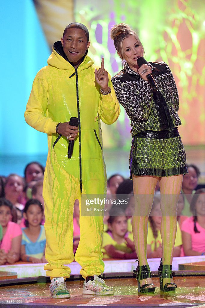 Musician <a gi-track='captionPersonalityLinkClicked' href=/galleries/search?phrase=Pharrell+Williams&family=editorial&specificpeople=161396 ng-click='$event.stopPropagation()'>Pharrell Williams</a> and actress <a gi-track='captionPersonalityLinkClicked' href=/galleries/search?phrase=Kaley+Cuoco&family=editorial&specificpeople=208988 ng-click='$event.stopPropagation()'>Kaley Cuoco</a> onstage at Nickelodeon's 27th Annual Kids' Choice Awards at USC Galen Center on March 29, 2014 in Los Angeles, California.
