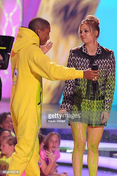 Musician Pharrell Williams and actress Kaley Cuoco Sweeting get slimed onstage during Nickelodeon's 27th Annual Kids' Choice Awards held at USC Galen...