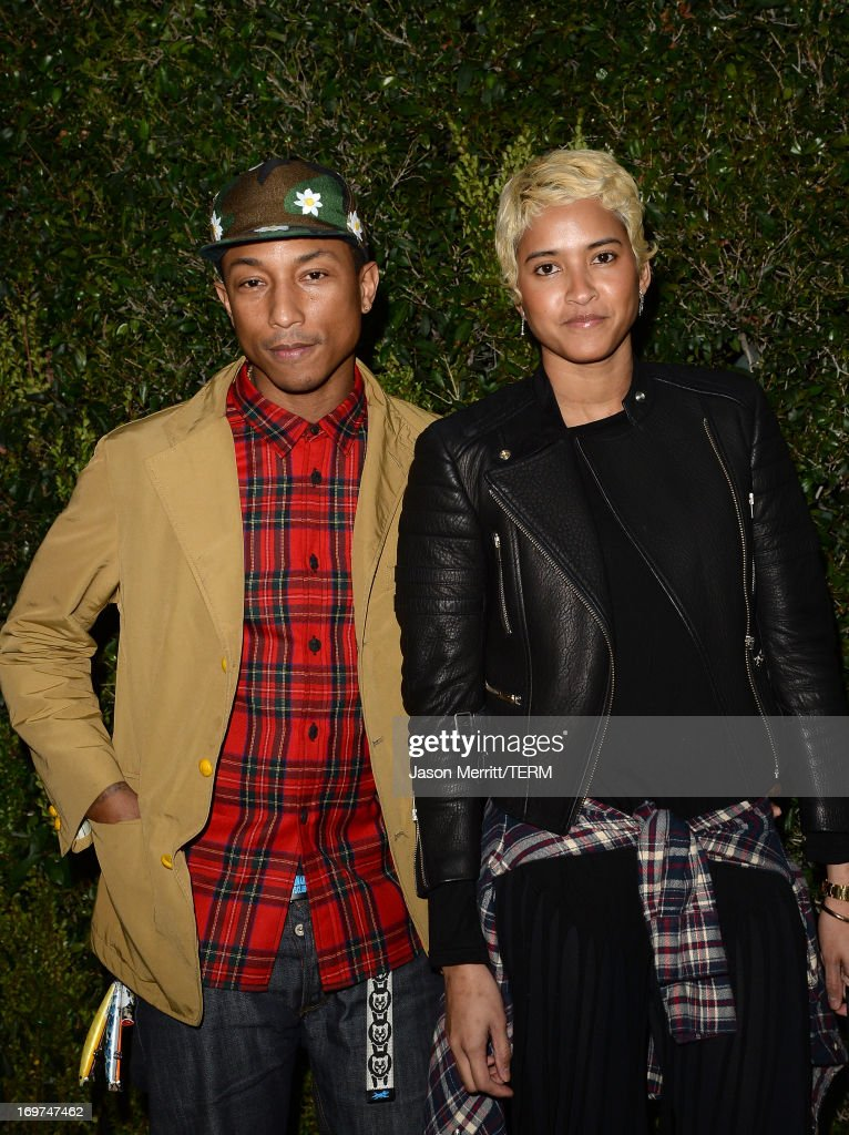 Musician <a gi-track='captionPersonalityLinkClicked' href=/galleries/search?phrase=Pharrell+Williams&family=editorial&specificpeople=161396 ng-click='$event.stopPropagation()'>Pharrell Williams</a> and Helen Lasichanh attend the CHANEL Dinner For NRDC 'A Celebration Of Art, Nature And Technology' held at a private residence on May 31, 2013 in Los Angeles, California.