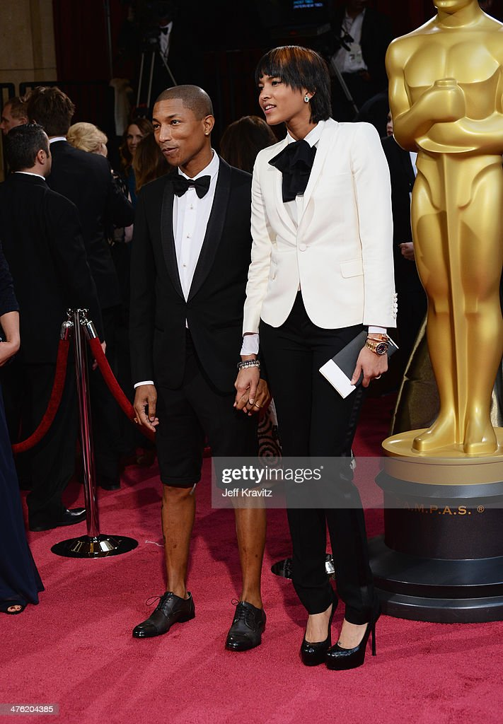 Musician Pharrell Williams and Helen Lasichanh attend the Oscars held at Hollywood & Highland Center on March 2, 2014 in Hollywood, California.