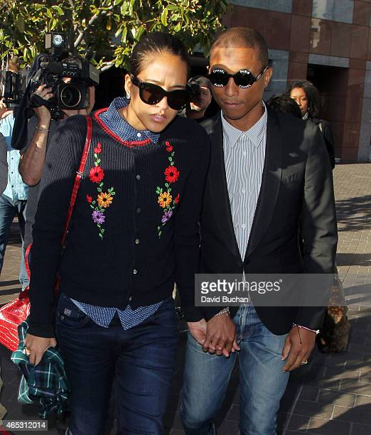 Musician Pharrell Williams and his wife Helen Lasichanh are seen outside the Roybal Federal Building on March 5 2015 in Los Angeles California...
