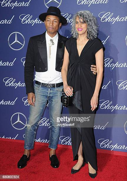 Musician Pharrell Williams and Mimi Valdes arrive at the 28th Annual Palm Springs International Film Festival Film Awards Gala at Palm Springs...
