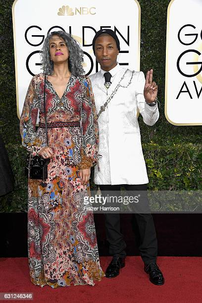 Musician Pharrell Williams and Mimi Valdes attend the 74th Annual Golden Globe Awards at The Beverly Hilton Hotel on January 8 2017 in Beverly Hills...