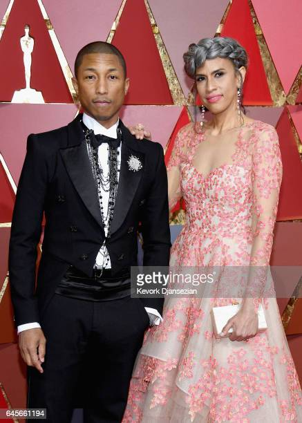 Musician Pharrell Williams and Mimi Valdes attends the 89th Annual Academy Awards at Hollywood Highland Center on February 26 2017 in Hollywood...