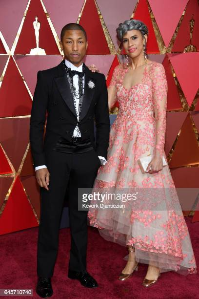 Musician Pharrell Williams and Model Helen Lasichanh attend the 89th Annual Academy Awards at Hollywood Highland Center on February 26 2017 in...