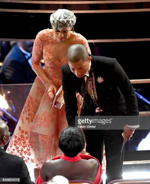 Musician Pharrell Williams and producer Mimi Valdes in the audience during the 89th Annual Academy Awards at Hollywood Highland Center on February 26...