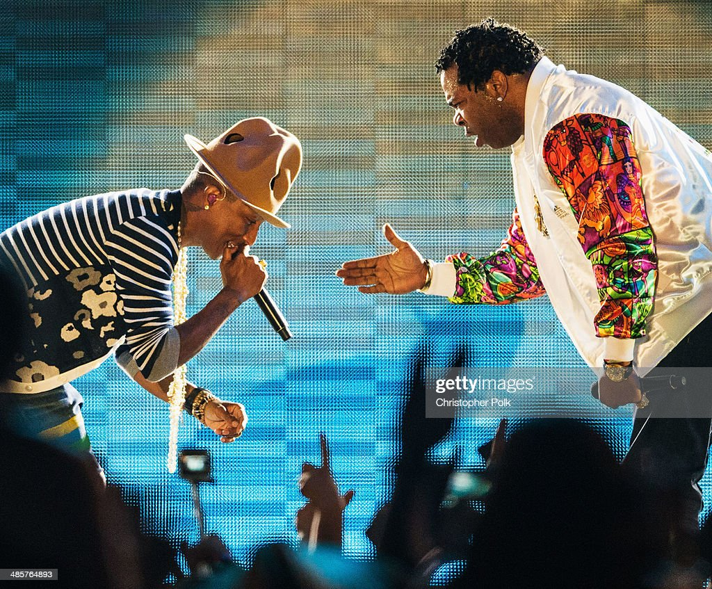 Musician <a gi-track='captionPersonalityLinkClicked' href=/galleries/search?phrase=Pharrell+Williams&family=editorial&specificpeople=161396 ng-click='$event.stopPropagation()'>Pharrell Williams</a> (L) and rapper <a gi-track='captionPersonalityLinkClicked' href=/galleries/search?phrase=Busta+Rhymes&family=editorial&specificpeople=208120 ng-click='$event.stopPropagation()'>Busta Rhymes</a> perform onstage during day 2 of the 2014 Coachella Valley Music & Arts Festival at the Empire Polo Club on April 19, 2014 in Indio, California.