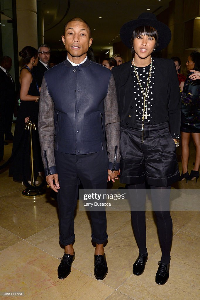 Musician Pharrell Williams (L) and wife Helen Lasichanh attend the 56th annual GRAMMY Awards Pre-GRAMMY Gala and Salute to Industry Icons honoring Lucian Grainge at The Beverly Hilton on January 25, 2014 in Beverly Hills, California.