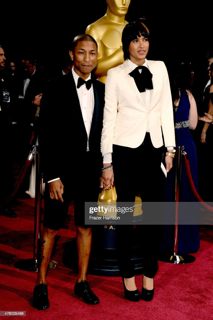 Musician Pharrell Williams (L) and wife Helen Lasichanh attend the Oscars held at Hollywood & Highland Center on March 2, 2014 in Hollywood, California.