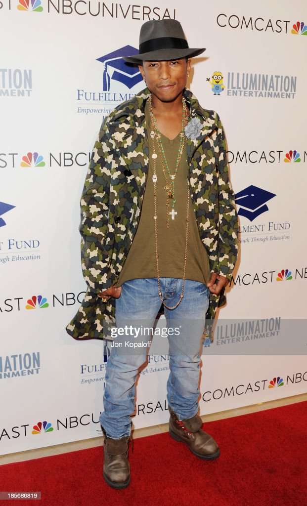 Musician <a gi-track='captionPersonalityLinkClicked' href=/galleries/search?phrase=Pharrell+Williams&family=editorial&specificpeople=161396 ng-click='$event.stopPropagation()'>Pharrell Williams</a> arrives at Fulfillment Fund Stars 2013 Benefit Gala at The Beverly Hilton Hotel on October 23, 2013 in Beverly Hills, California.