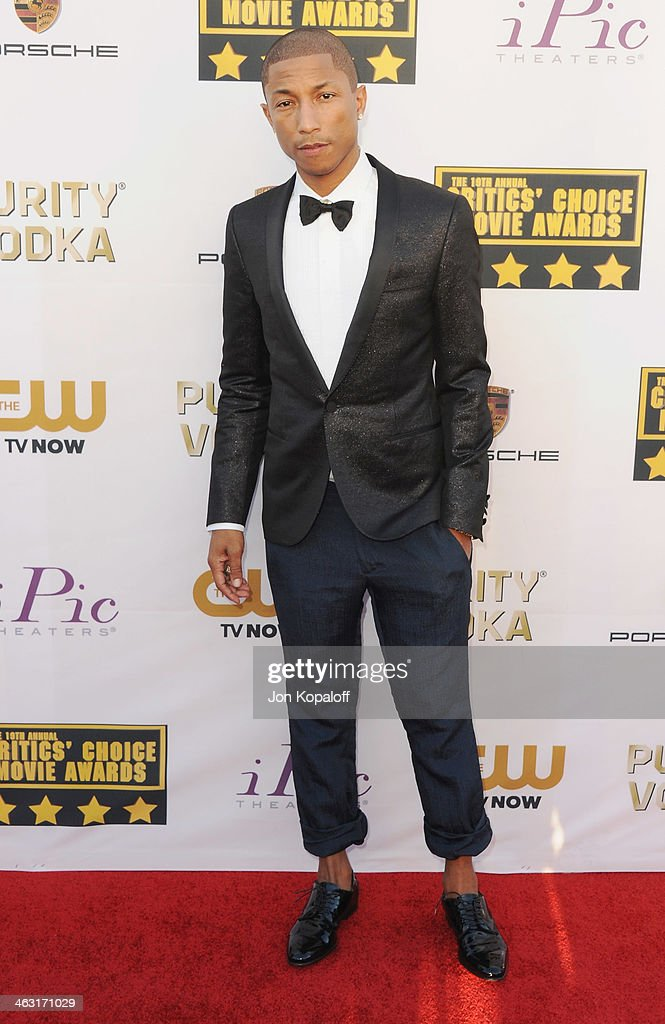 Musician <a gi-track='captionPersonalityLinkClicked' href=/galleries/search?phrase=Pharrell+Williams&family=editorial&specificpeople=161396 ng-click='$event.stopPropagation()'>Pharrell Williams</a> arrives at the 19th Annual Critics' Choice Movie Awards at Barker Hangar on January 16, 2014 in Santa Monica, California.
