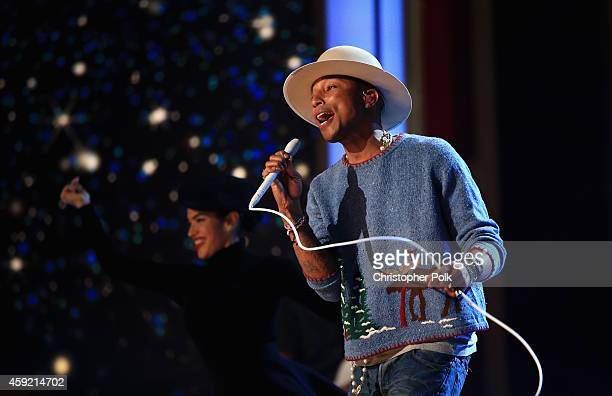 Musician Pharrell Williams performs onstage during A VERY GRAMMY CHRISTMAS at The Shrine Auditorium on November 18 2014 in Los Angeles California