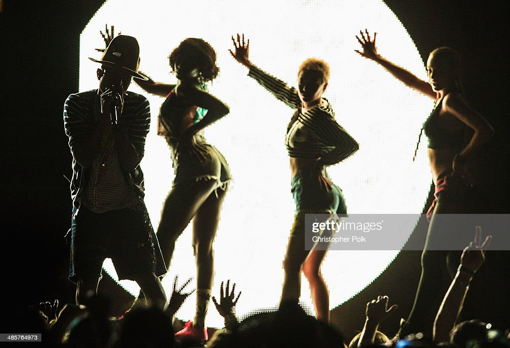 Musician <a gi-track='captionPersonalityLinkClicked' href=/galleries/search?phrase=Pharrell+Williams&family=editorial&specificpeople=161396 ng-click='$event.stopPropagation()'>Pharrell Williams</a> performs onstage during day 2 of the 2014 Coachella Valley Music & Arts Festival at the Empire Polo Club on April 19, 2014 in Indio, California.