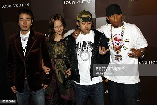 Musician Pharrell Williams poses with Chad Hugo unidentified guest and Nigo during the Louis Vuitton Store Launch the opening of the longawaited...